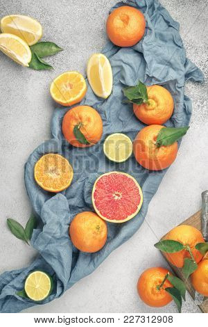 Citrus Background. Assorted Fresh Citrus Fruits With Leaves. Grapefruit, Lemon, Lime, Tangerine.