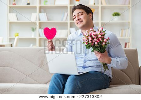 Young man making marriage proposal over internet laptop