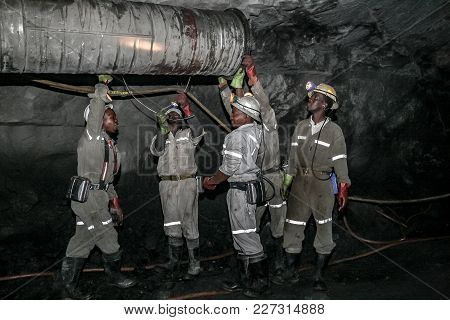 Rustenburg, South Africa, 08/08/2011, Underground Platinum Miners Fitting A Ventilation Pipe