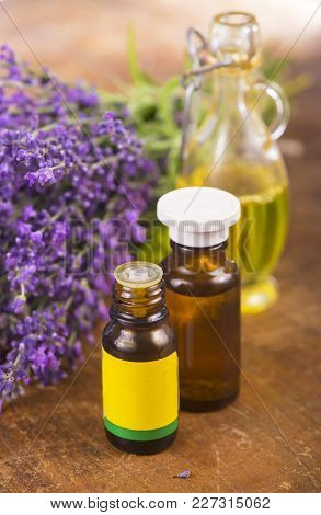 Lavender Oil With Fresh Lavender On A Wooden Background