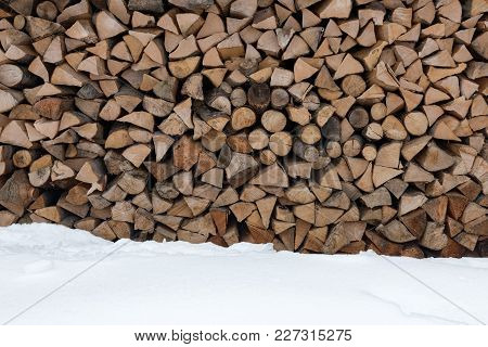 Folded Firewood. Old Firewood For The Fireplace. Wooden Texture