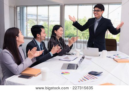 Businesspeople Meeting And Presentation In Conference Room., Business And Finance Concepts