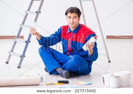 Young painter trying to match colours for painting job