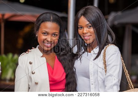 Cape Town, South Africa - November 10, 2015. Ladies At Glamourous Event Looking At Camera.