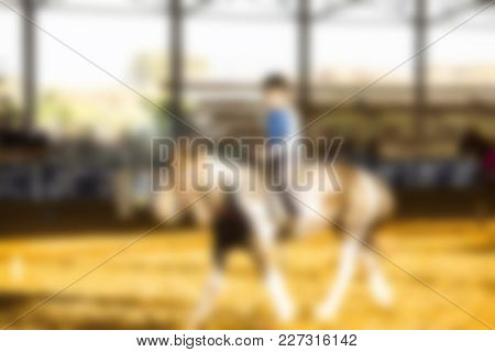 Abstract Blurred Background. Horse Riding Lessons For Kids.