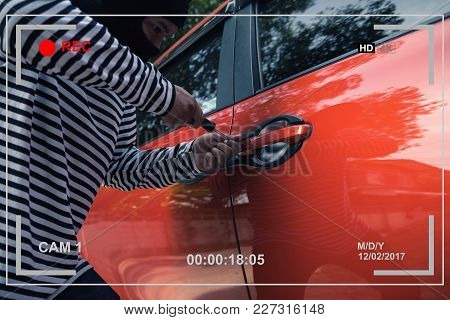 Video Capturing Car Thief Trying To Unlock A Car By Screwdriver.