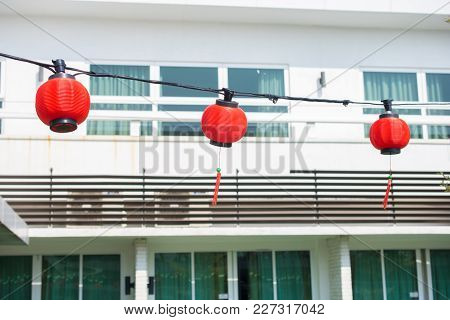 Chinese Red Lanterns Hanging At Street For Decoration During The Chinese New Year.