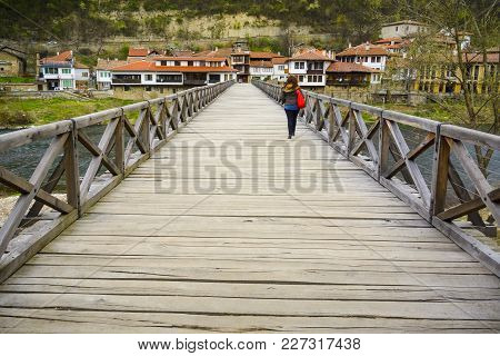 Veliko Tarnovo, Bulgaria, 05 April, 2015: Young Woman Cross The Bishop's Bridge , This Is A 250 Year