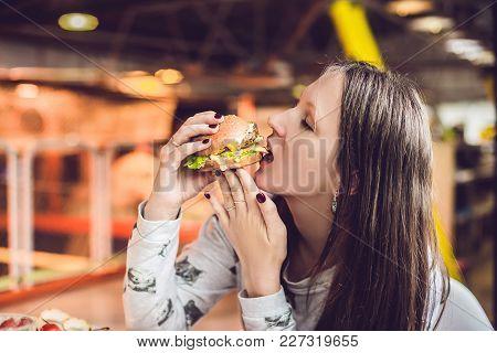 Young Woman Eating Hamburger Woman Eating Junk Food, Fatty Food Hamburger