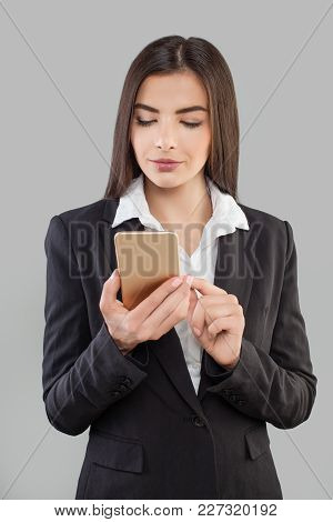 Latin Business Woman With Smartphone. Cute Executive Wearing Suit Calling Customer Service On The Ph