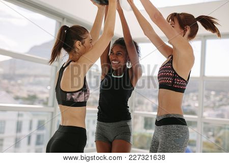 Smiling Women Having Fun At Fitness Studio