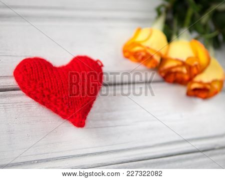 Soft Red Heart And Orange Roses On A White Table