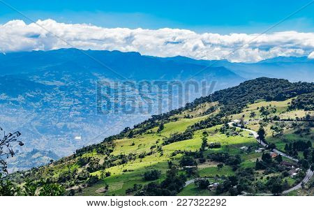Road In A Typical Landscape Of The Mountainous Area Of Colombia Composed Of Green Valleys And Mounta