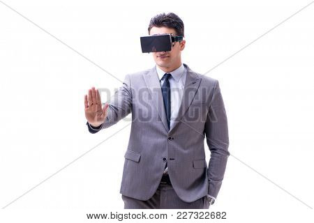 Businessman wearing virtual reality VR glasses isolated on white