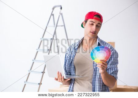 Young painter contractor choosing colors for home renovation