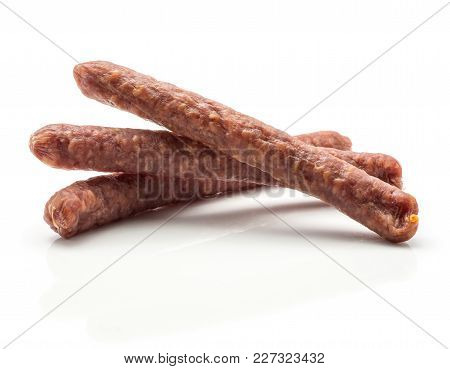 Hungarian Dry Sausages Pepperoni Fan Isolated On White Background Three Smoked In Natural Casing Mix