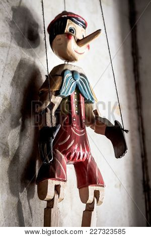 Selective Focus Abstract Image Of A Wooden String Puppet Boy