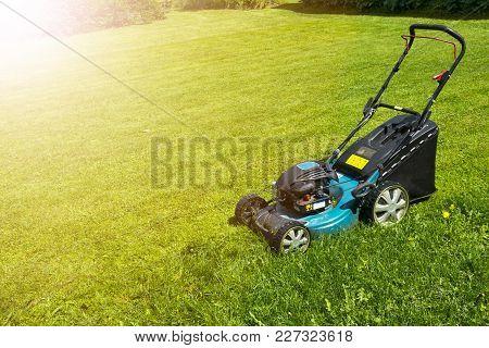Mowing Lawns Lawn Mower On Green Grass Mower Grass Equipment Mowing Gardener Care Work Tool Close Up
