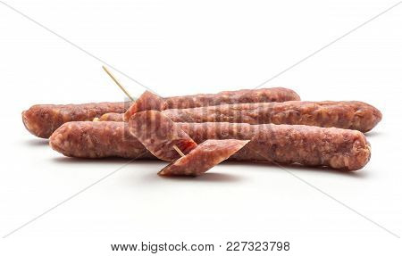 Three Hungarian Dry Sausages Pepperoni And Two Pieces Isolated On White Background Smoked In Natural