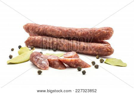 Hungarian Dry Sausages Pepperoni With Black Pepper Bay Leaves And Cut Pieces Isolated On White Backg