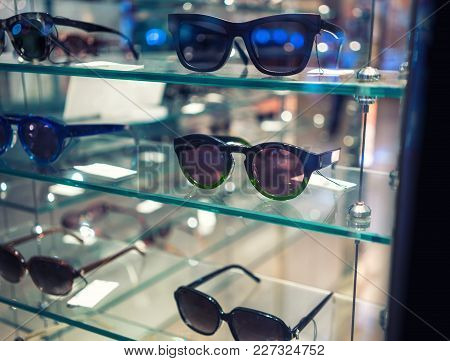 Various Of Sun Glasses In The Shop Display Shelves. Selective Focus