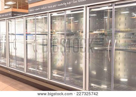Empty Commercial Fridges At Grocery Store In America
