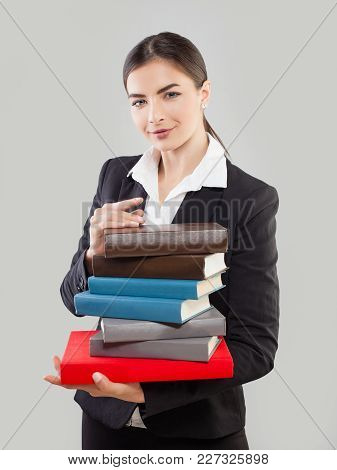 Young Woman Student With Book On Gray Background