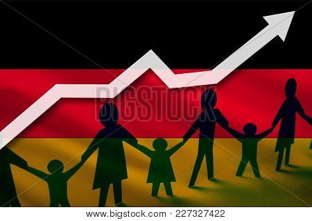 Germany Flag On A Background Of A Growing Arrow Up And People With Children Holding Hands. Demograph