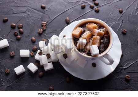 Sugar Addict. Heap Overabundance Of Sugar In A Cup Of Coffee On A Black Table With Scattered Coffee