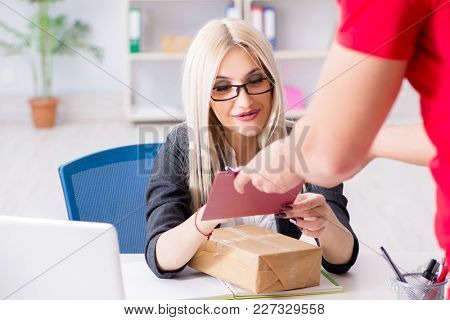 Woman businesswoman receiving mail parcel from courier