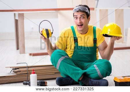 Worker showing the importnace of wearing noise cancelling headph