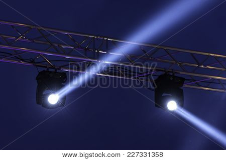 Stage Lights On Concert. Lighting Equipment With White Beams.