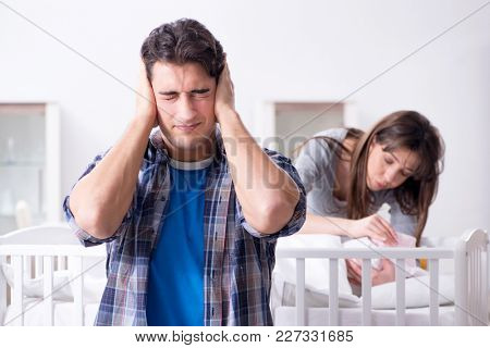 Young dad cannot stand baby crying