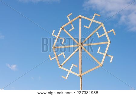 Traditional Lithuanian Ethno Symbols Made From Wood In Front Of Blue Spring Sky
