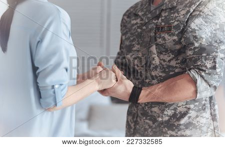Do Not Let Anything Happen To You. Scaled Up Shot Of A Couple Holding Hands Tightly While Saying The