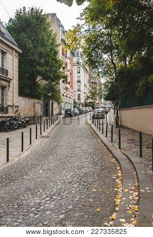 Cobblestone Road Moving Up The Hill Of Montmartre In Autumn Paris, France