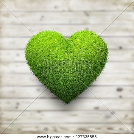 Heart Shape Of Green Grass Over Wood Background