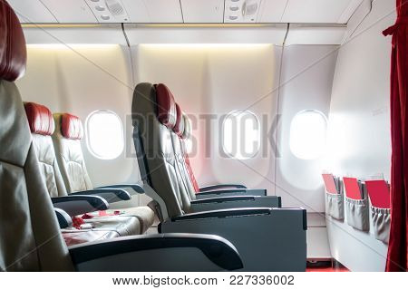 Empty passenger airplane economy seats in the cabin