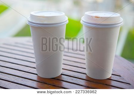 Two White Paper Cup For Hot Coffee Or Tea On Wood Table