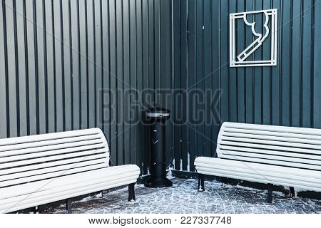 Zone For Smoking With Ash Bin And Wooden White Benches. Permission For Smoking In Special Place. Are