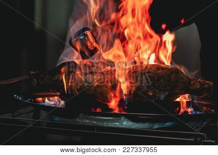 Appetizing Grilled Meat On Fire Close-up. Beautiful Presentation Of The Dishes In The Restaurant.