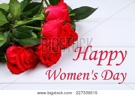 Happy Woman's Day. March 8. Roses On A White Wooden Table.