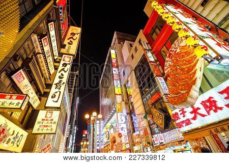 Osaka, Japan - April 29, 2017: Prospective View Of Namba District By Night With Various Food Signage