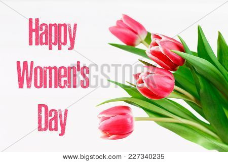 Happy Woman's Day. March 8. Tulips On A White Wooden Table.