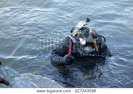 Industrial Diver With Scuba Gear And Hammer Working In The Water At The Shore Reinforcement, Copy Sp