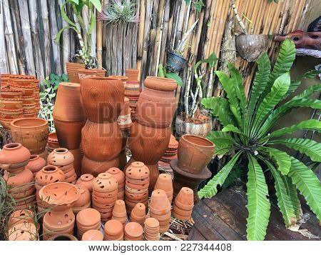Assortment Of Handmaiden Empty Flowerpots. Terracotta Clay Pots For Garden Plants And Flowers. Decor
