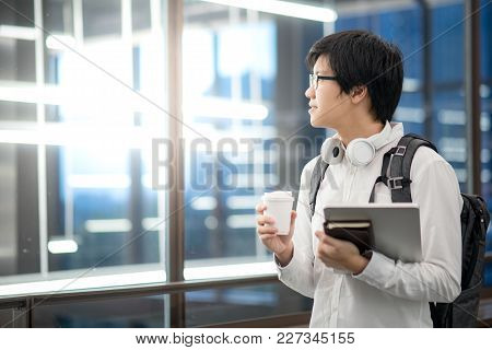 Young Asian Man University Student Holding Laptop Computer, Notebook And Coffee Cup, Happy Lifestyle