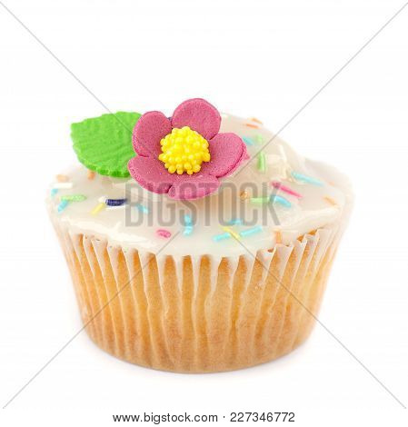 Cupcake With Sugar Frosting, Sprinkles And Flower Isolated