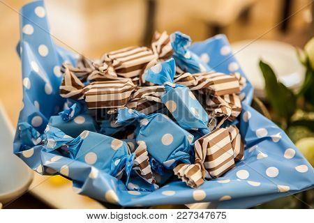 Small Candies In Blue And Brown Wrappers