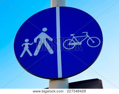 Pedestrian Crossing And Bycicle  Path Traffic Sign Against Beautiful Blue Sky.